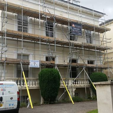 Scaffolding around a house, ready to be painted