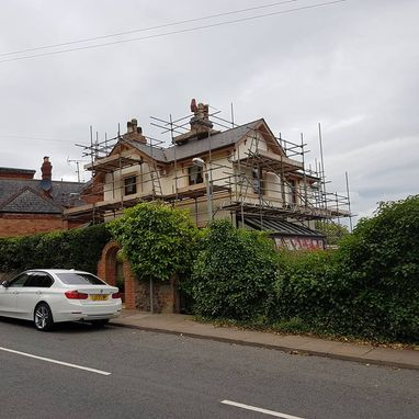 scaffolding around a house ready to be painted